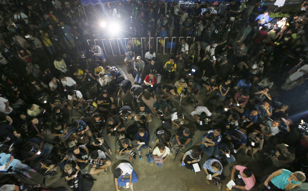 Thai media listen Chiang Rai province acting Gov. Narongsak Osatanakorn, who is leading the ongoing rescue operation of the soccer team and coach trapped in a flooded cave, during a press conferen ...