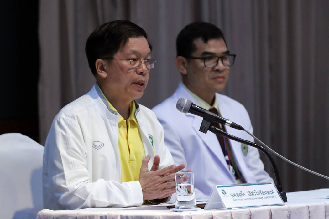 Thongchai Lertwilairatanapong, a public health inspector, left, speaks during a press conference at a hospital in Chiang Rai province, northern Thailand, Wednesday, July 11, 2018. Thongchai said t ...