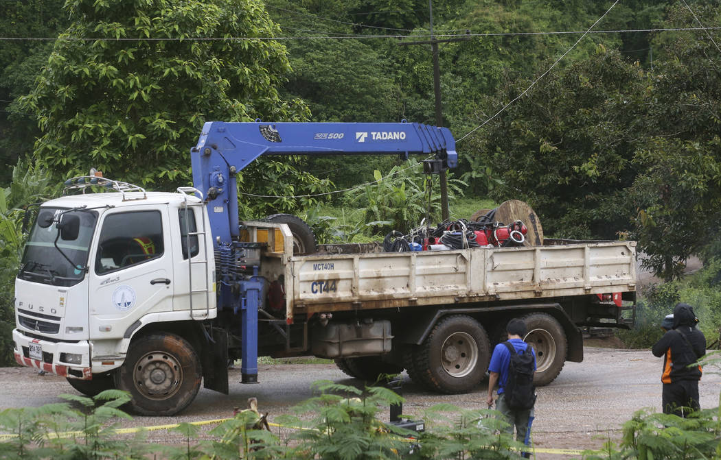 A truck carries giant water pumps away from the cave rescue area in Mae Sai, Chiang Rai province, northern Thailand, Wednesday, July 11, 2018. A daring rescue mission in the treacherous confines o ...
