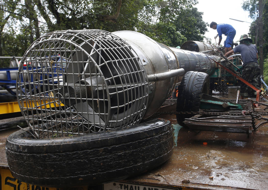 Thai workers clean a giant water pump as they prepare to leave a cave rescue area in Mae Sai, Chiang Rai province, northern Thailand, Wednesday, July 11, 2018. A daring rescue mission in the treac ...