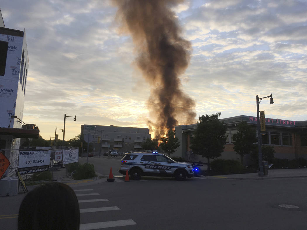 A large plume of smoke from a massive fire is seen in Sun Prairie, Wis., Tuesday, July 10, 2018. Witnesses said the fire broke out after a loud boom Tuesday night shook the community. Police block ...