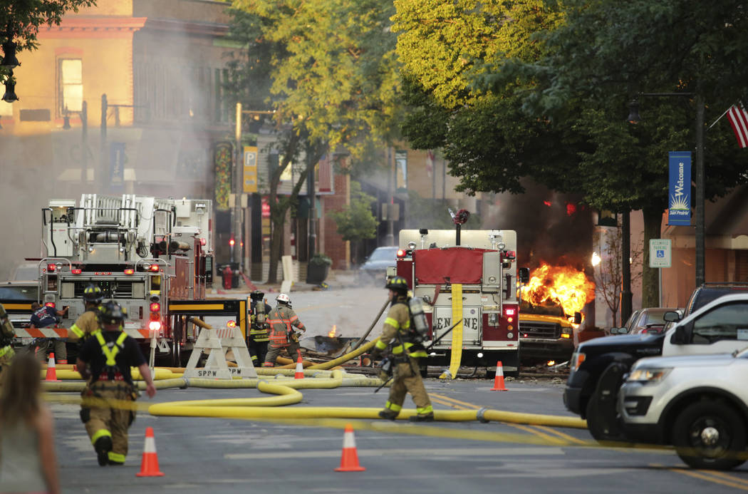 Firefighters work the scene of an explosion in downtown Sun Prairie, Wis., Tuesday, July 10, 2018. The explosion rocked the downtown area of Sun Prairie, a suburb of Madison, after a contractor st ...