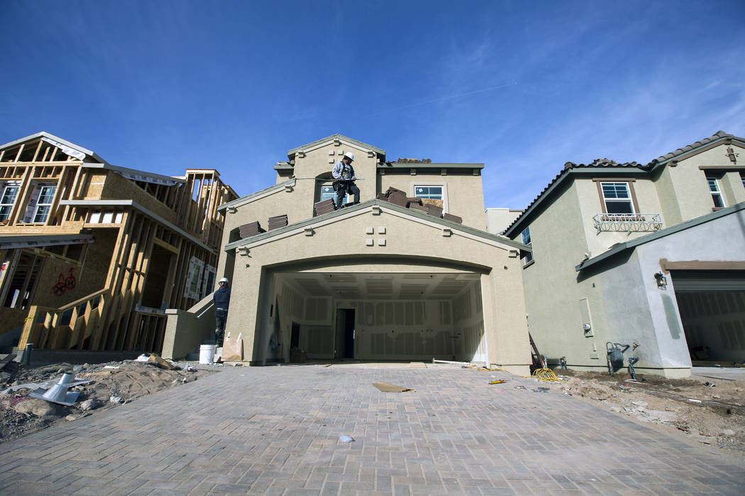 A man works on a single-family home at Cadence, a 2,300-acre master planned community, in Henderson in 2016. (RJNewHomes.Vegas File Photo)