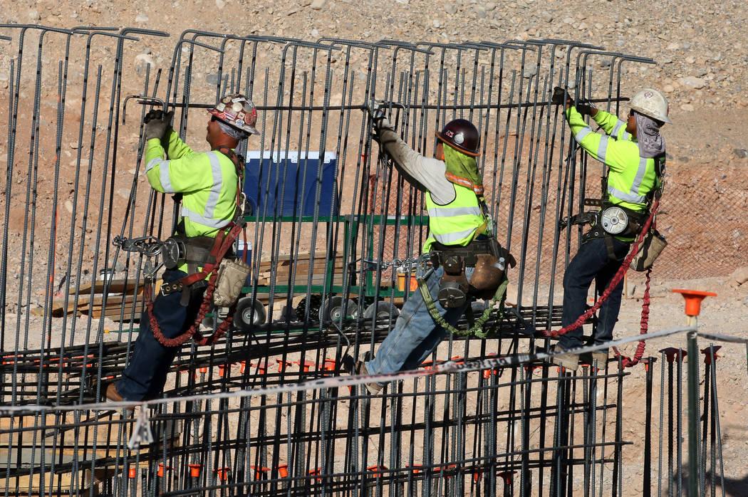 Workers tie rebar at the new Las Vegas ballpark construction site in Summerlin. (Bizuayehu Tesfaye RJNewHomes.Vegas)