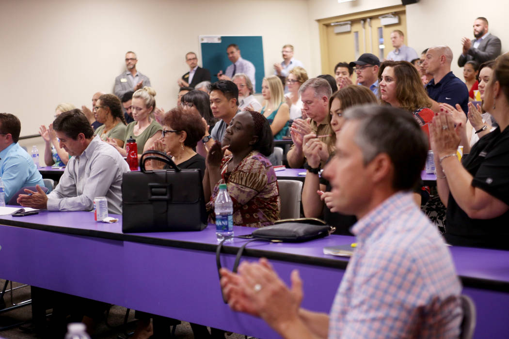 The crowd applauds after watching a video about Swift, Apple's a program language used for coding, at the College of Southern Nevada in Las Vegas, Thursday, July 12, 2018. Swift will be used in co ...