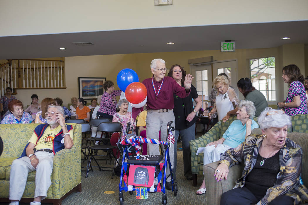 Gene Stephens greets family and friends at his 100th birthday party at Atria Seville Senior Living in Las Vegas, Thursday, July 12, 2018. Stephens is the last surviving member of the original Mili ...