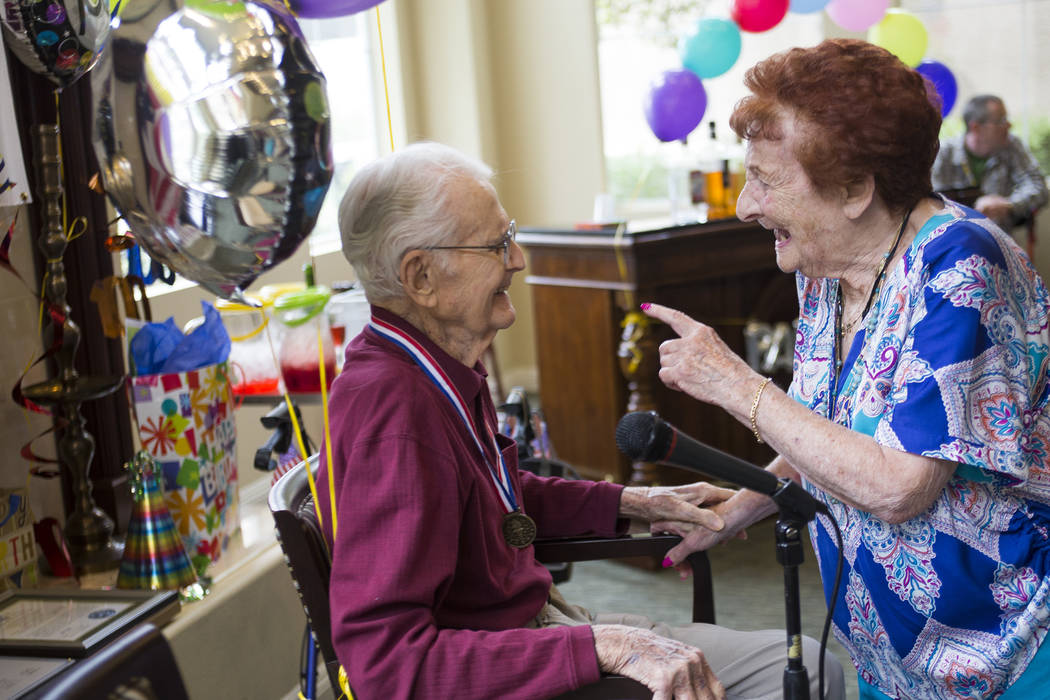 Ellen Block greets Gene Stephens at his 100th birthday party at Atria Seville Senior Living in Las Vegas, Thursday, July 12, 2018. Dozens of family and friends attended to celebrate with him. Bloc ...