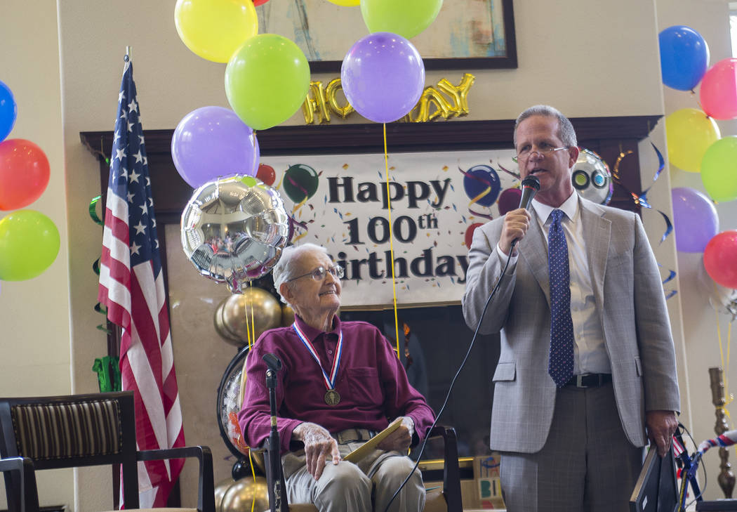 Lt. Gov. Mark Hutchinson speaks about Gene Stephens' character as a self-made man at his 100th birthday party at Atria Seville Senior Living in Las Vegas, Thursday, July 12, 2018. Hutchinson gave ...