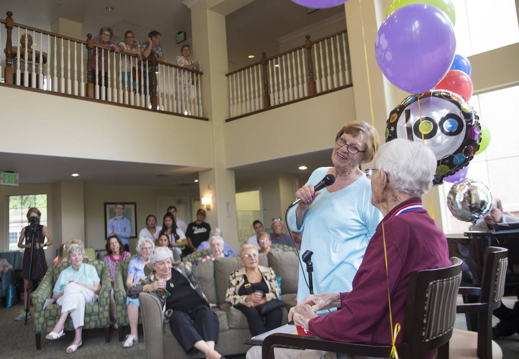 Ellen Eppler tells stories about her uncle Gene Stephens at his 100th birthday party at Atria Seville Senior Living in Las Vegas, Thursday, July 12, 2018. Dozens of family and friends attended to ...