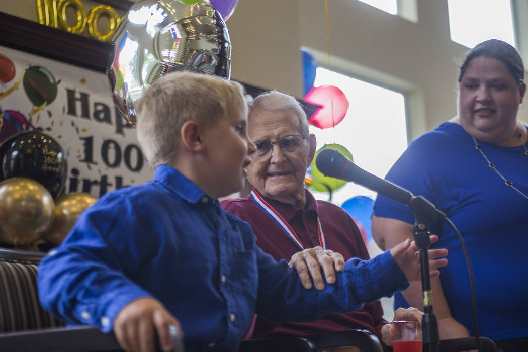 Rhys Stephens, 7, says happy birthday to his great grandfather Gene Stephens at his 100th birthday party at Atria Seville Senior Living in Las Vegas, Thursday, July 12, 2018. Dozens of family and ...