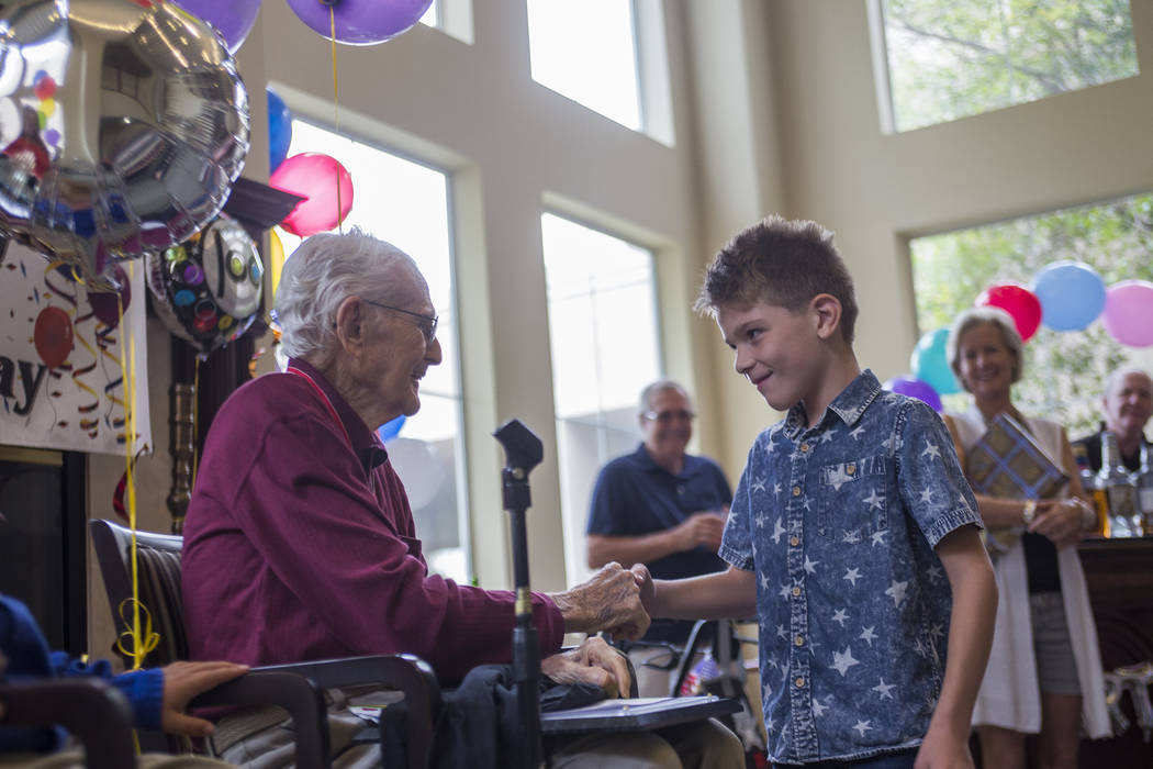 Joe Vosicky, 7, says happy birthday Gene Stephens at his 100th birthday party at Atria Seville Senior Living in Las Vegas, Thursday, July 12, 2018. Dozens of family and friends attended to celebra ...