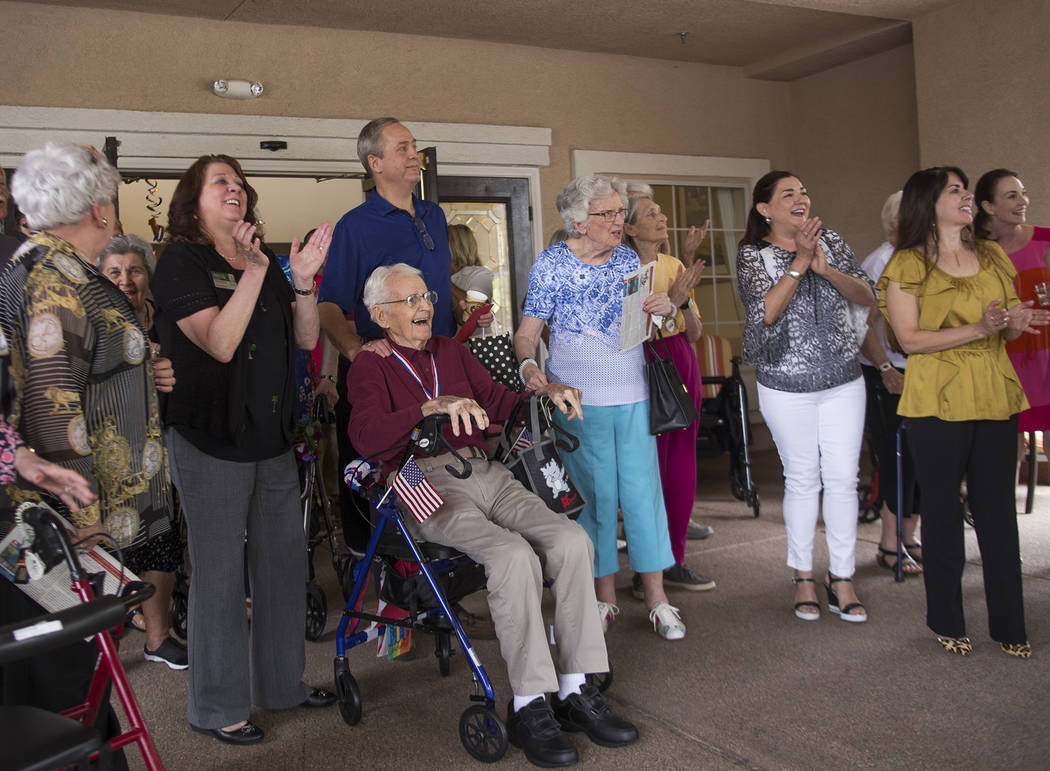 Gene Stephens reacts as dozens of motorcyclists, including Metro police officers, pull up for his 100th birthday party at Atria Seville Senior Living in Las Vegas, Thursday, July 12, 2018. Rachel ...