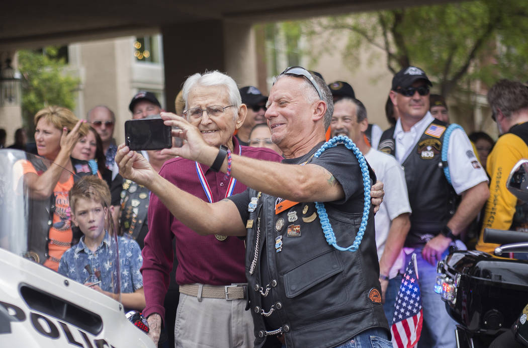 Dennis Brochey, right, takes a selfie with Gene Stephens at his 100th birthday party at Atria Seville Senior Living in Las Vegas, Thursday, July 12, 2018. Dozens of motorcyclists stopped by as wel ...