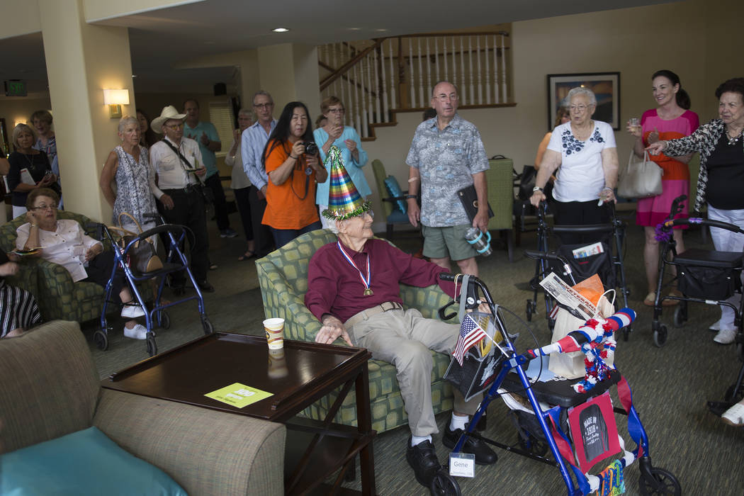 Family and friends sing happy birthday to Gene Stephens at his 100th birthday party at Atria Seville Senior Living in Las Vegas, Thursday, July 12, 2018. Rachel Aston Las Vegas Review-Journal @roo ...