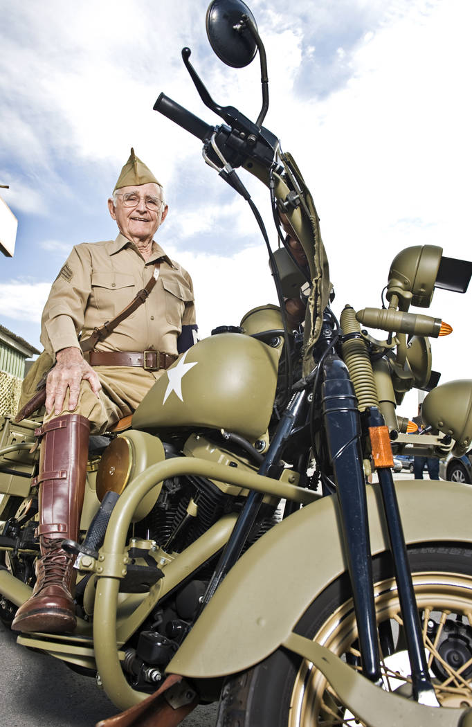 World War II veteran Gene Stephens, 94, wears his Military Police Corps uniform as he poses on a vintage motorcycle at Battlefield Vegas, a military theme park on Industrial Road near Circus Circu ...