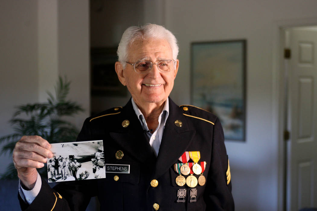 Gene Stephens holds a picture of like Frank Sinatra, one of many celebrities that he escorted as a military policeman in World War II in Algiers and Rome as part of the 281st MP Company. Thursday, ...