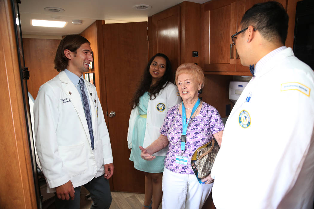 Phillis Christian, third from left, who lives in assisted living in Las Vegas, gets a tour of the new Touro University Nevada mobile healthcare clinic by student doctors from left, Daniel DeMers, ...