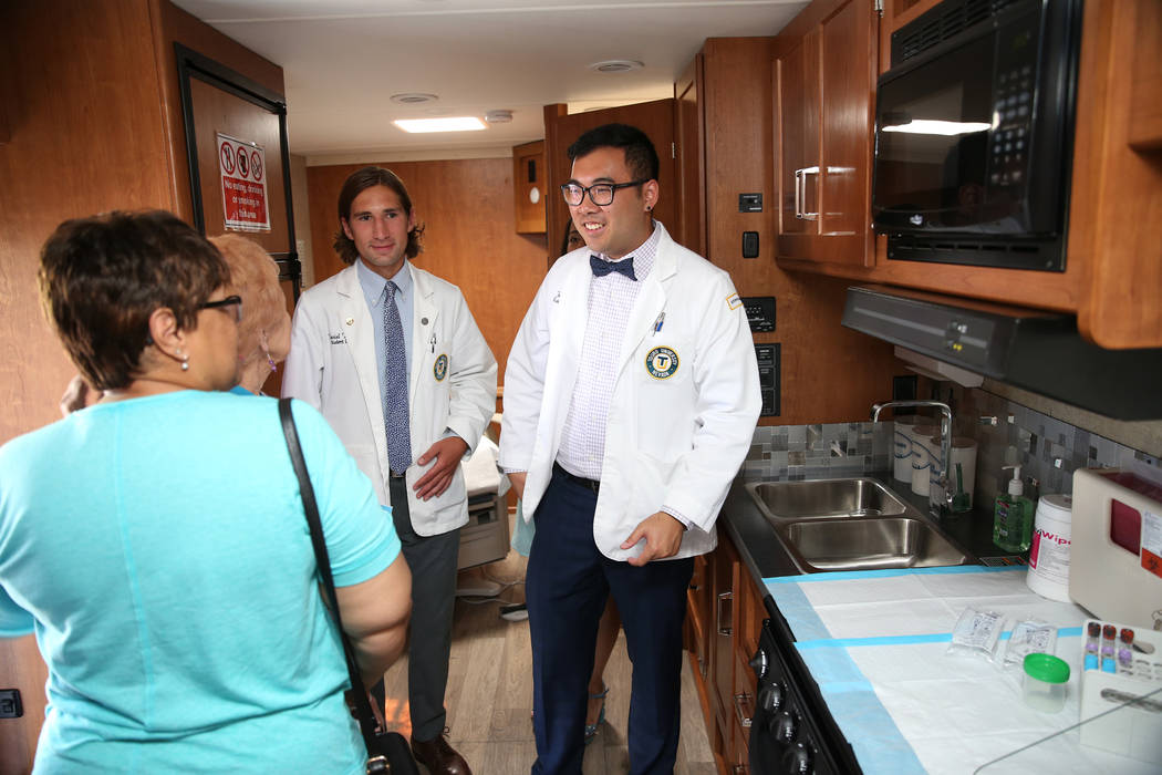Student doctors Daniel DeMers, left, and Jason Ma, show the new Touro University Nevada mobile healthcare clinic parked outside at City National Arena in Las Vegas, Thursday, July 19, 2018. Erik V ...
