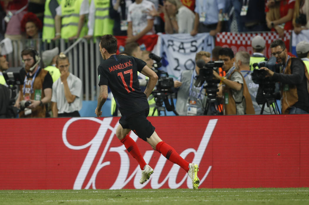 Croatia's Mario Mandzukic celebrates after scoring his side's second goal during the semifinal match between Croatia and England at the 2018 soccer World Cup in the Luzhniki Stadium in Moscow, Rus ...