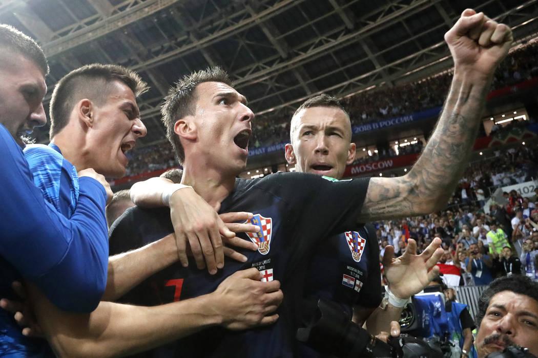 Croatia's Mario Mandzukic, center, celebrates after scoring his side's second goal during the semifinal match between Croatia and England at the 2018 soccer World Cup in the Luzhniki Stadium in Mo ...