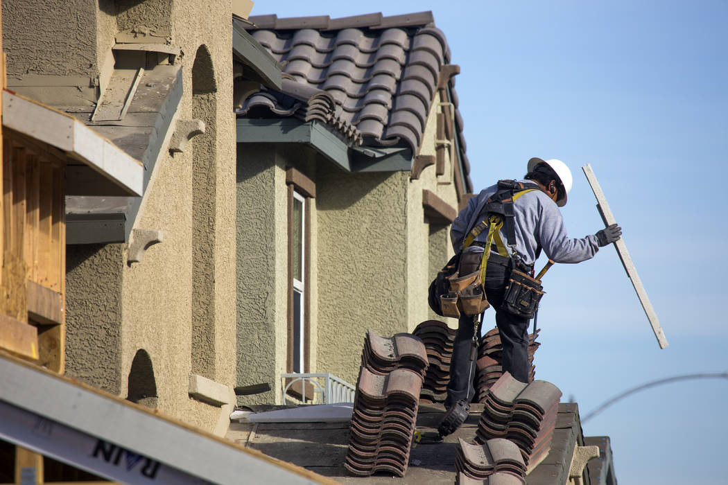 A man works on a single-family homes at Cadence, in 2016. (Las Vegas Review-Journal File Photo)