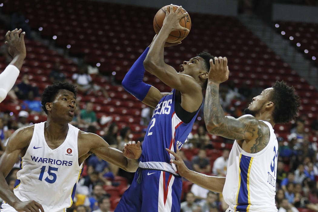 Golden State Warriors' Damian Jones, left, and J.P Tokoto guard Los Angeles Clippers' Shai Gilgeous-Alexander during the second half of an NBA summer league basketball game Friday, July 6, 2018, i ...