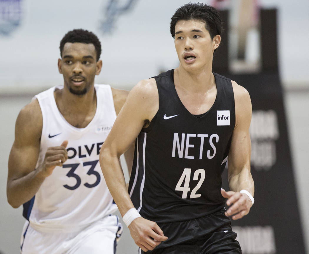 Nets forward Yuta Watanabe (42) sprints up court with Minnesota Timberwolves forward Keita Bates-Diop (33) during the NBA Summer League on Monday, July 9, 2018, at Cox Pavilion, in Las Vegas. Benj ...