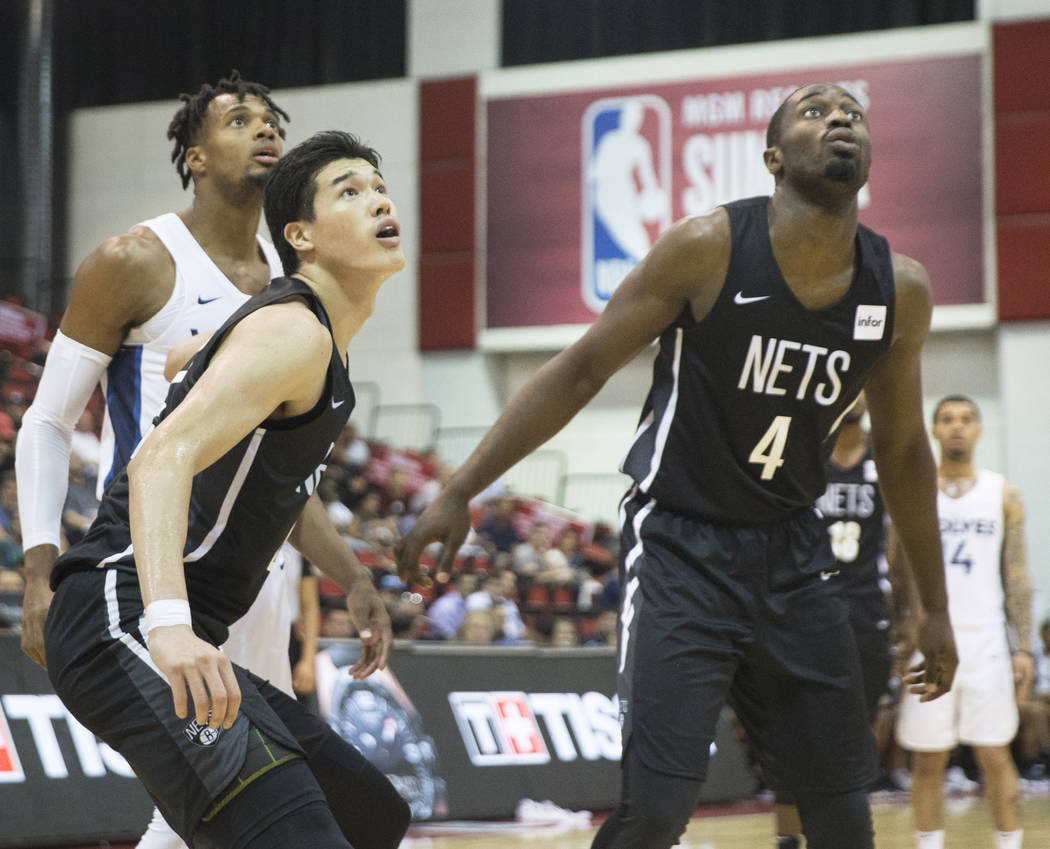 Nets forward Yuta Watanabe (42) and Theo Pinson (4) box out a Minnesota Timberwolves defender during the NBA Summer League on Monday, July 9, 2018, at Cox Pavilion, in Las Vegas. Benjamin Hager La ...