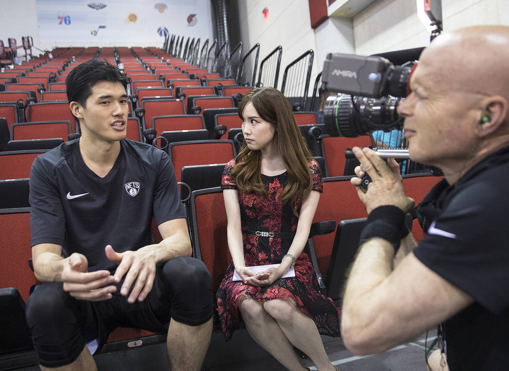 Nets forward Yuta Watanabe, left, addresses the media after Brooklyn's NBA Summer League game with the Minnesota Timberwolves on Monday, July 9, 2018, at Cox Pavilion, in Las Vegas. Benjamin Hager ...