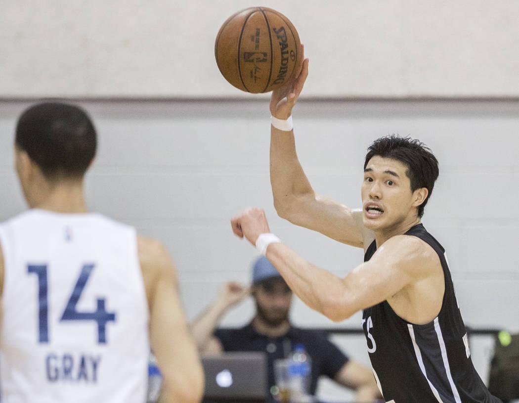 Nets forward Yuta Watanabe (42) makes a pass with Minnesota Timberwolves guard Josh Gray (14) defending during the NBA Summer League on Monday, July 9, 2018, at Cox Pavilion, in Las Vegas. Benjami ...