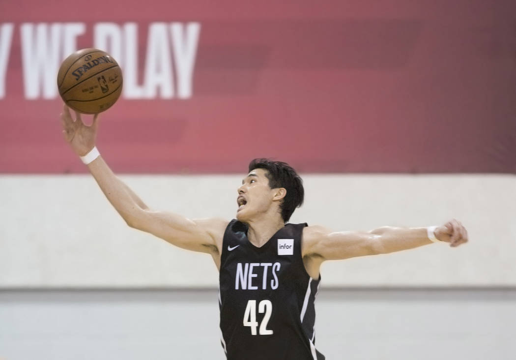 Nets forward Yuta Watanabe (42) grabs a rebound during Brooklyn's NBA Summer League game with the Minnesota Timberwolves on Monday, July 9, 2018, at Cox Pavilion, in Las Vegas. Benjamin Hager Las ...