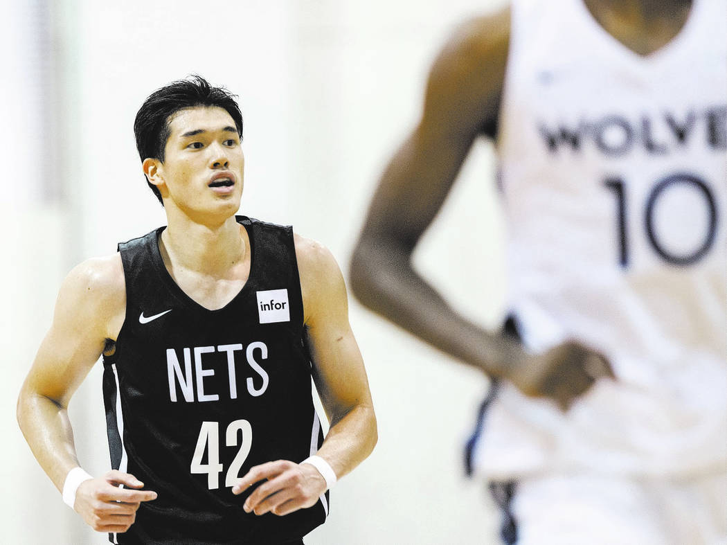 Nets forward Yuta Watanabe (42) sprints up court with Minnesota Timberwolves forward Amile Jefferson (10) during the NBA Summer League on Monday, July 9, 2018, at Cox Pavilion, in Las Vegas. Benja ...