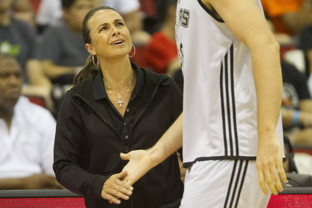 Becky Hammon, summer head basketball coach for the San Antonio Spurs, talks to a player during the NBA Summer League game against the Sacramento Kings at Cox Pavilion on Friday, July 15, 2016, in ...