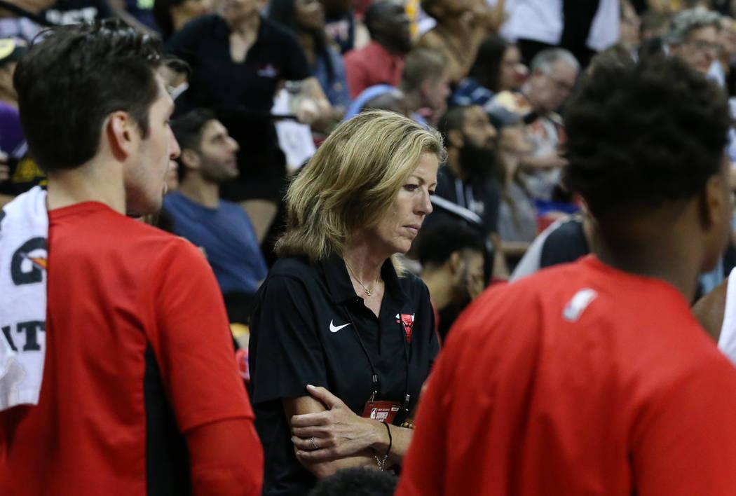 The Chicago Bulls Summer League associate coach Karen Umlauf, center, listens as Summer League head coach Randy Brown, not photographed, talks to his players during an NBA Summer League basketball ...