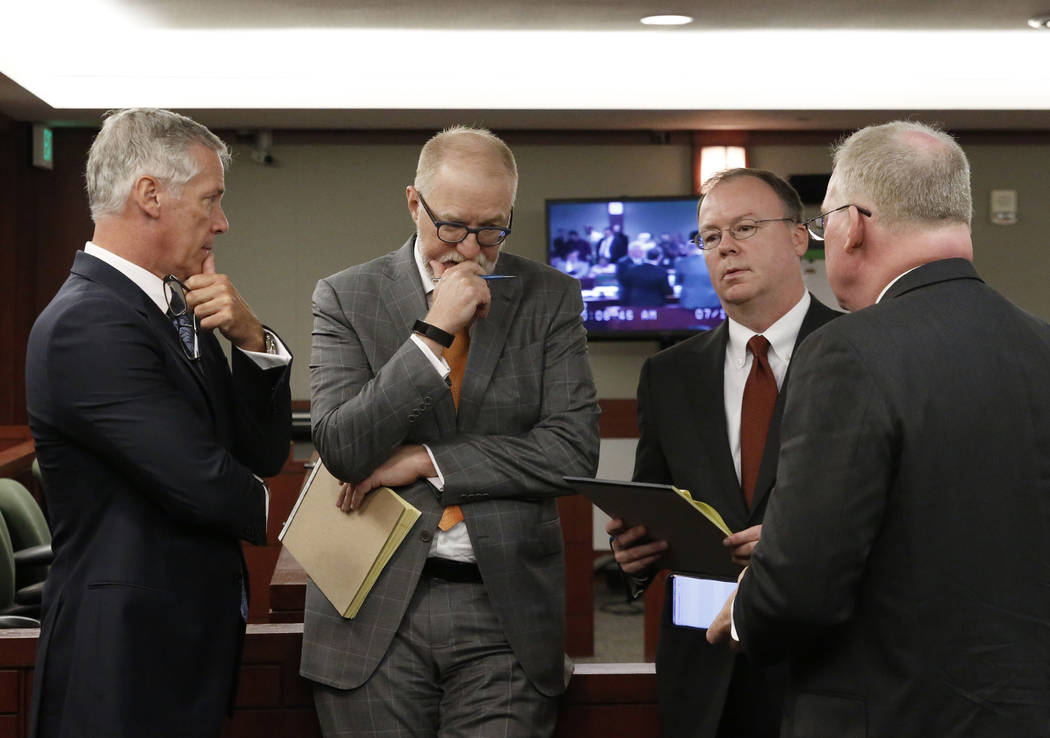 Attorneys James Pisanelli, left, Todd Bice, Kenneth Schuler, and Michael Faris, right, representing drug manufacturer, Alvogen, appear at the Regional Justice Center during a hearing on Friday, Ju ...