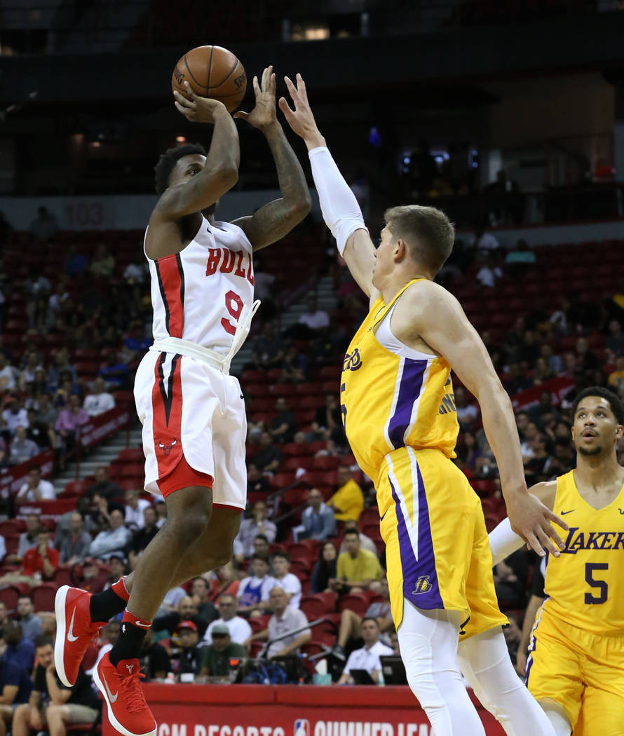 The Chicago Bulls guard Antonio Blakeney (9) shoots over the Los Angeles Lakers center Mortiz Wagner (15) at the Thomas and Mack Center during an NBA Summer League basketball game on Sunday, July ...