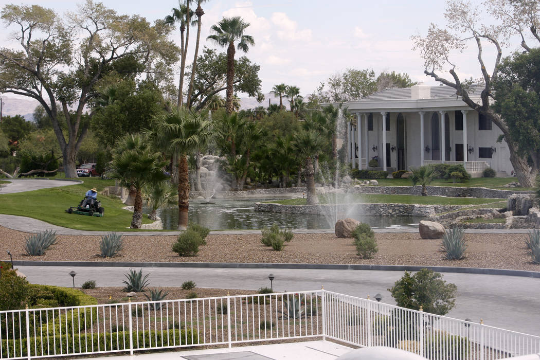 A worker cuts some of the 1,000,000-square-feet of grass at the former estate of former Strip headliner Wayne Newton Tuesday, Aug. 27, 2013. Newton's residence on the 38-acre at the corner of Suns ...