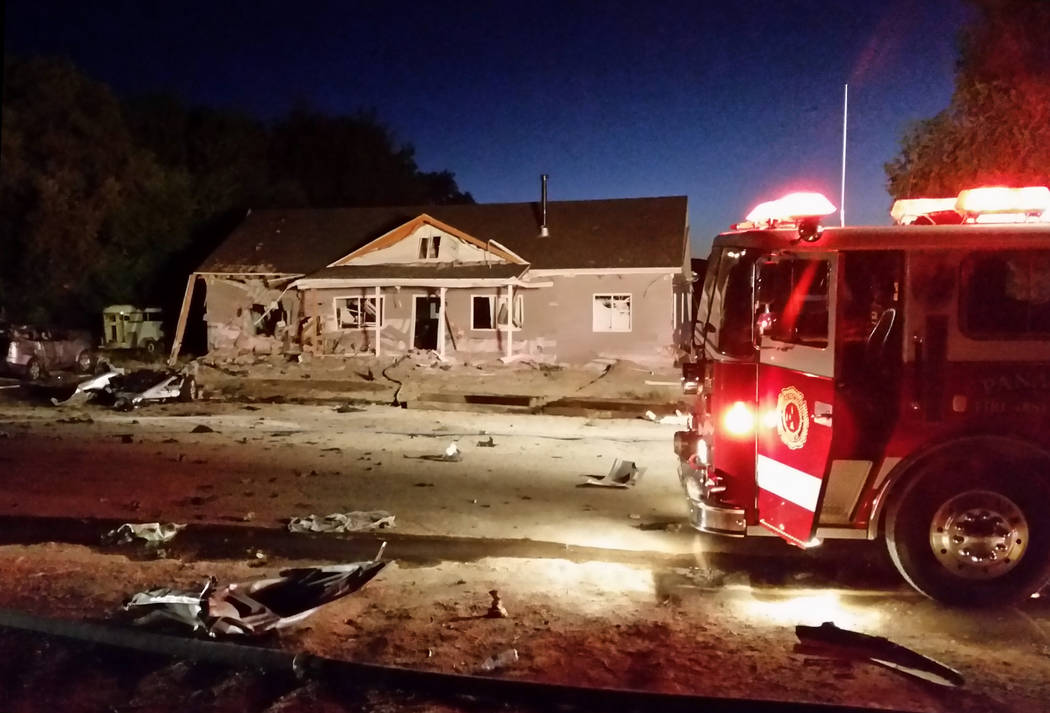 A fire truck sits in front of a house destroyed by a suicide bomb attack in Panaca on July 13, 2016. Two explosions shattered the structure and sent shrapnel raining down on the small Lincoln Coun ...