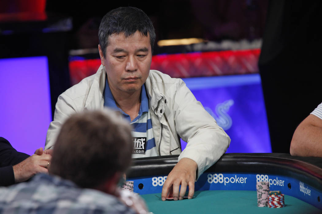 Yueqi Zhu places a bet on the seventh day of the World Series of Poker at the Rio Convention Center in Las Vegas, Wednesday, July 11, 2018. By the end of the night there will be only nine players ...