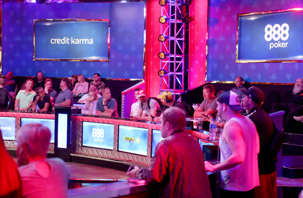 A crowd gathers to watch the main event table on the seventh day of the World Series of Poker at the Rio Convention Center in Las Vegas, Wednesday, July 11, 2018. By the end of the night there wil ...