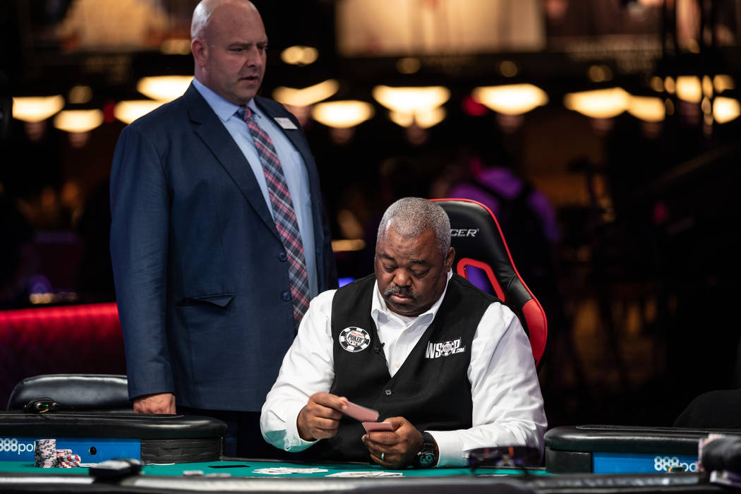 Tournament Director Charlie Ciresi approaches WSOP dealer Daniel Harris at the Rio in Las Vegas on Wednesday, July 11, 2018. (Todd Prince/ Las Vegas Review-Journal)