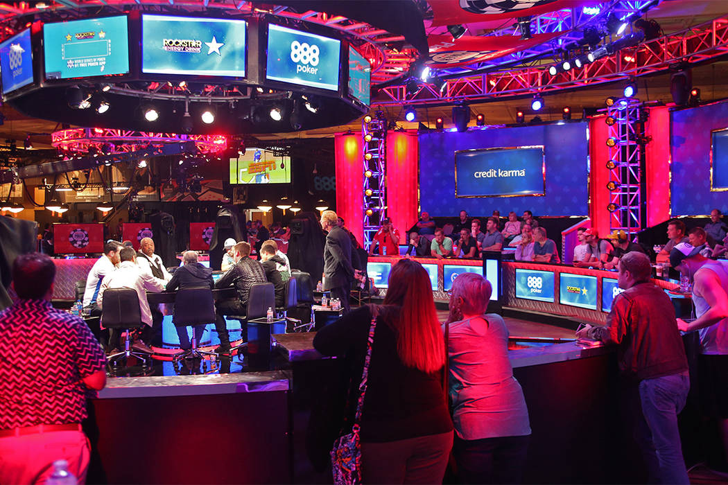 A crowd gathers to watch the main event table on the seventh day of the World Series of Poker at the Rio Convention Center in Las Vegas, Wednesday, July 11, 2018. (Rachel Aston/Las Vegas Review-Jo ...