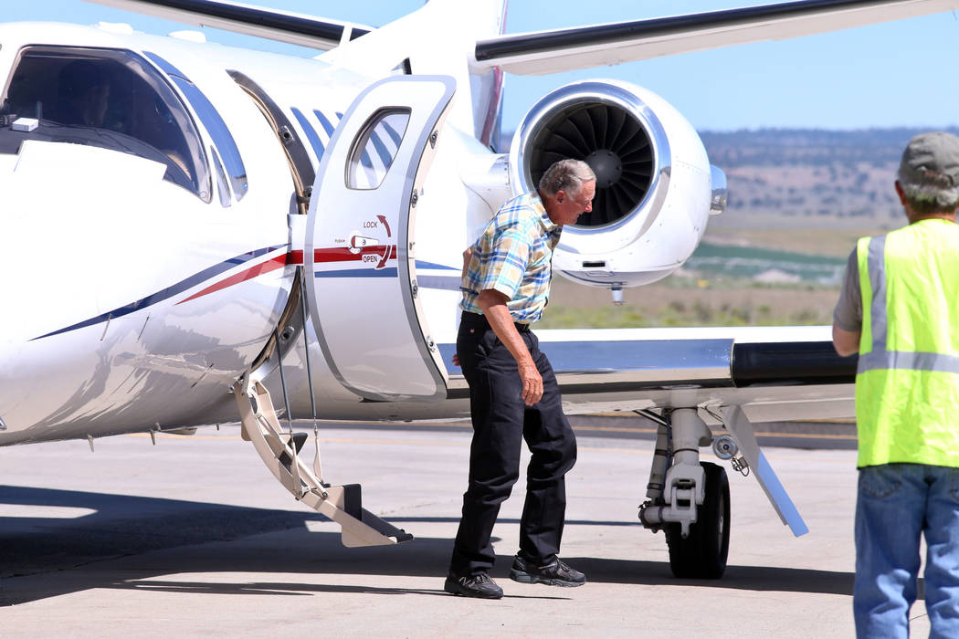 Rancher Dwight Hammond Jr. deplanes after arriving by private jet at the Burns Municipal Airport, Wednesday, July 11, 2018, in Burns, Ore. Hammond and his son Steven, convicted of intentionally se ...