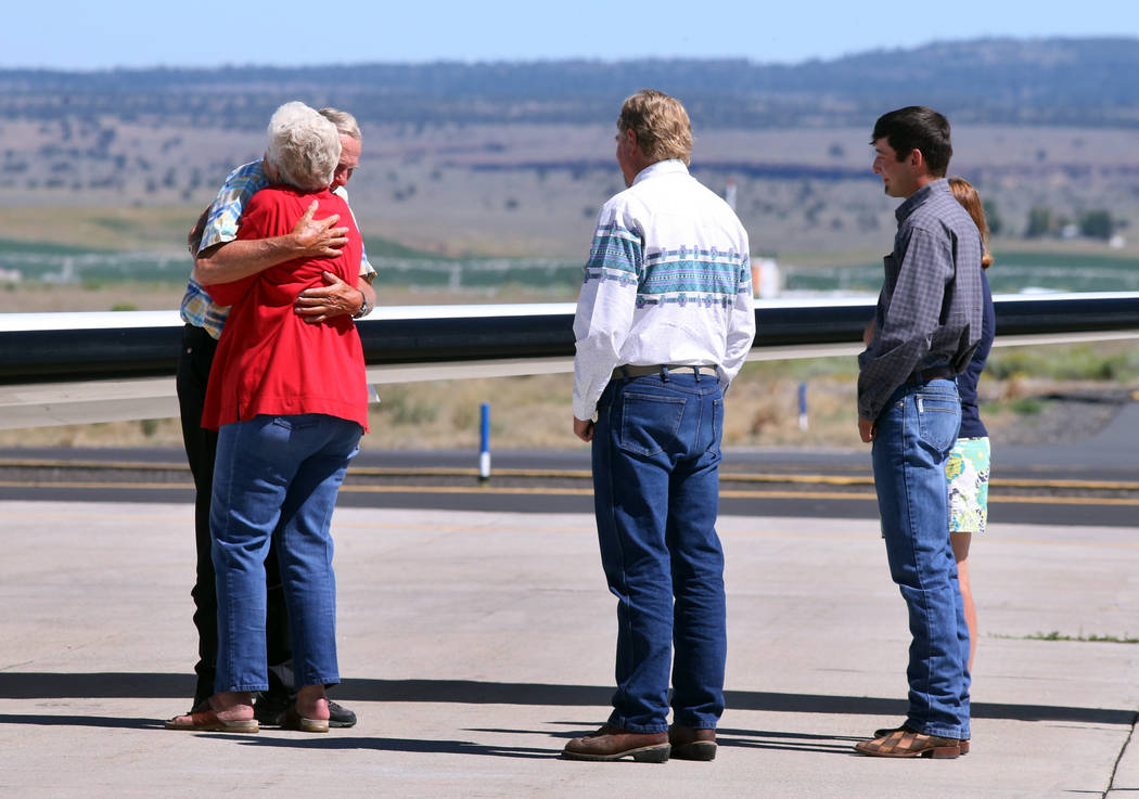 Rancher Dwight Hammond Jr. is embraced by his wife Susie Hammond after arriving by private jet at the Burns Municipal Airport, Wednesday, July 11, 2018, in Burns, Ore. Hammond and his son Steven, ...