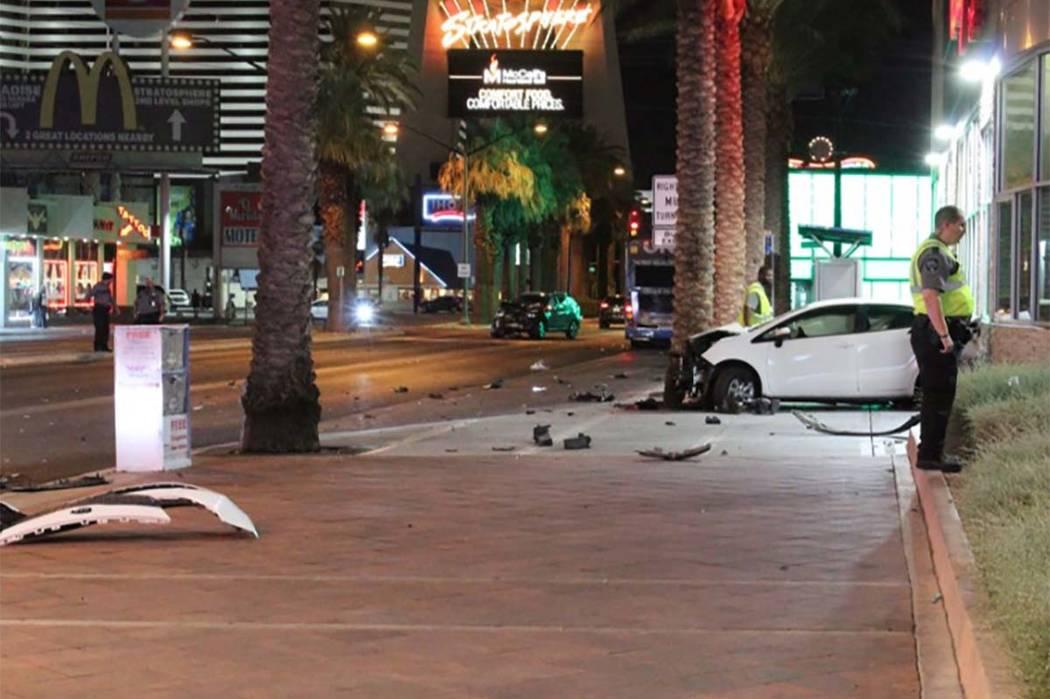 Las Vegas police investigate a crash on the Las Vegas Strip at Sahara Avenue on Thursday, July 12, 2018. (Max Michor/Las Vegas Review-Journal)