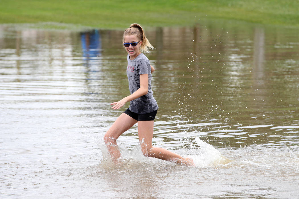 Terrylin Lemon, 12, plays in the water after a rain storm flooded the park off Wagonwheel Drive and Old Vegas Trail near U.S. Highway 95 in Henderson, Thursday, July 12, 2018. Erik Verduzco Las Ve ...