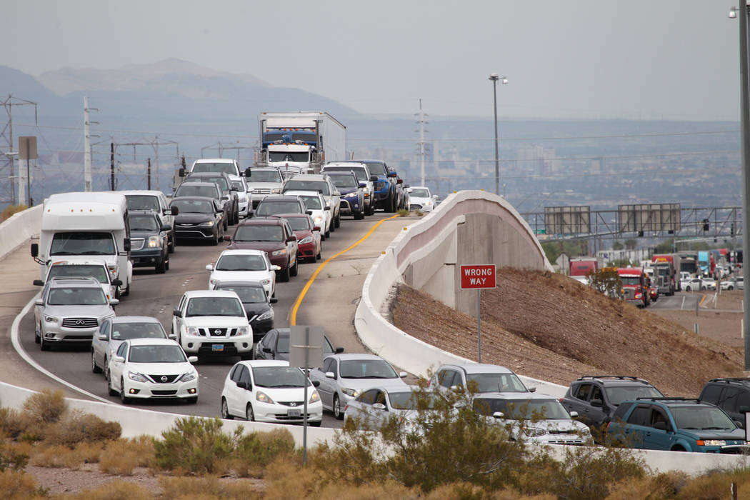 Heavy traffic on Boulder Highway after heavy rain flooded U.S. Highway 95 near Wagonwheel Drive causing it to shutdown in Henderson, Thursday, July 12, 2018. Erik Verduzco Las Vegas Review-Journal ...