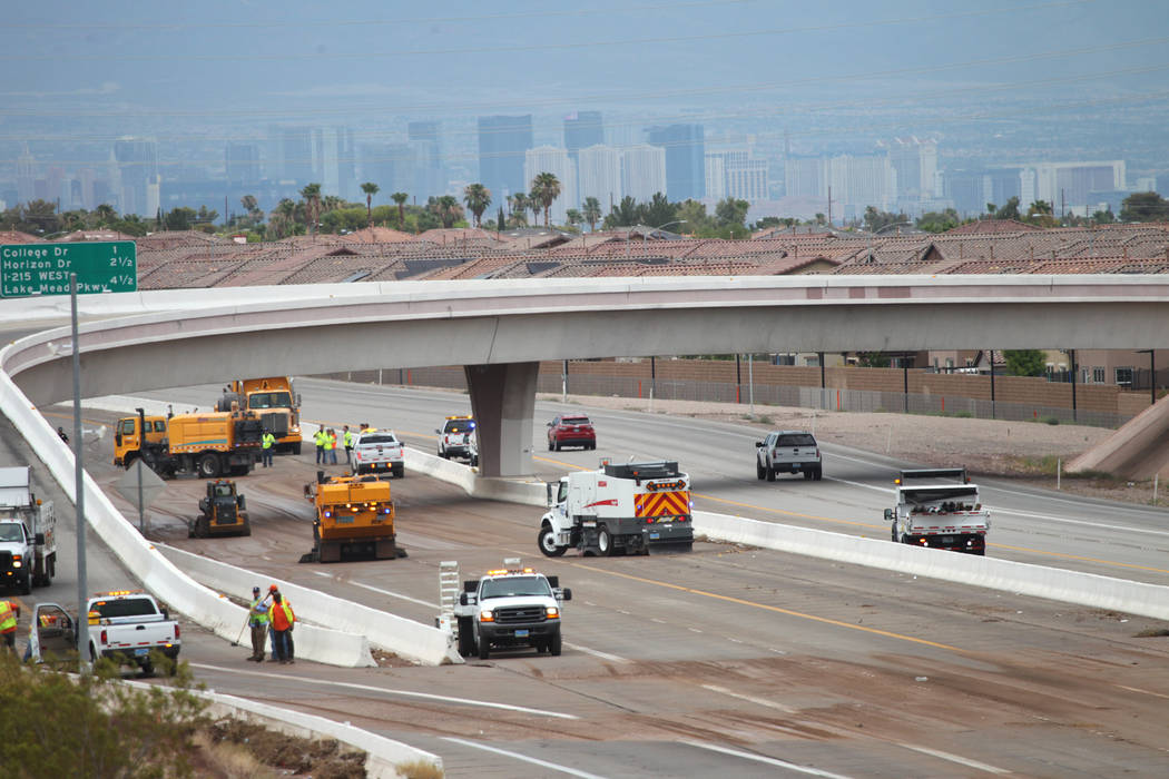 Cleaning crews work to clear U.S. Highway 95 near Wagonwheel Drive after a rain storm in Henderson, Thursday, July 12, 2018. Erik Verduzco Las Vegas Review-Journal @Erik_Verduzco