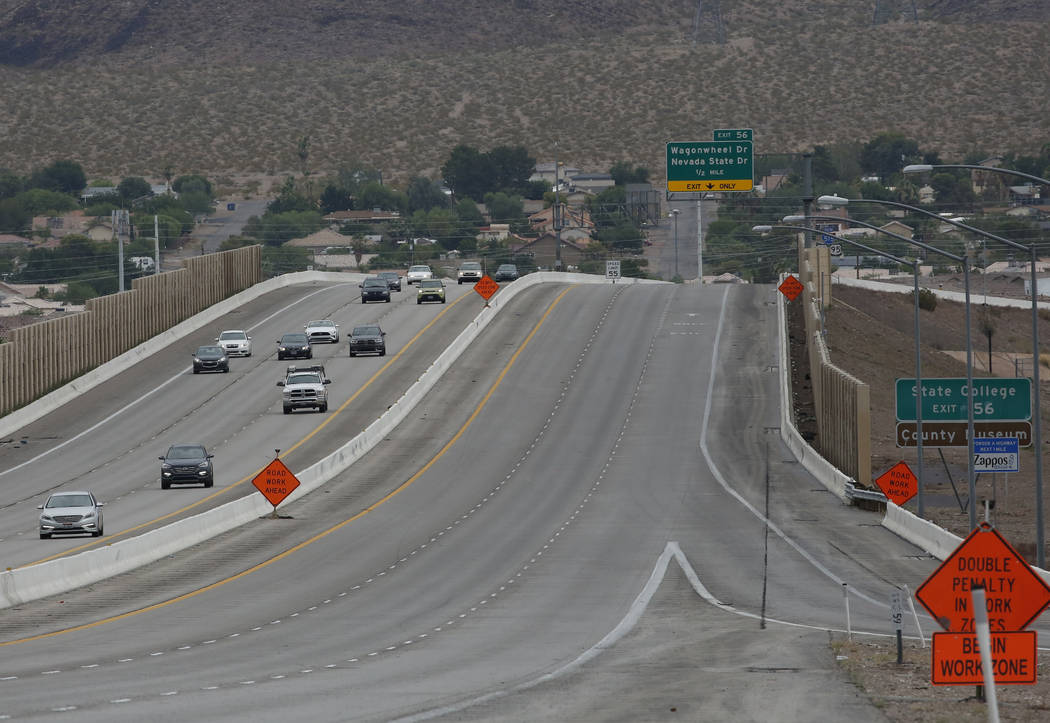 Southbound Interstate 515, right, is closed due to flooding on Thursday, July 12, 2018, in Henderson. Bizuayehu Tesfaye/Las Vegas Review-Journal @bizutesfaye