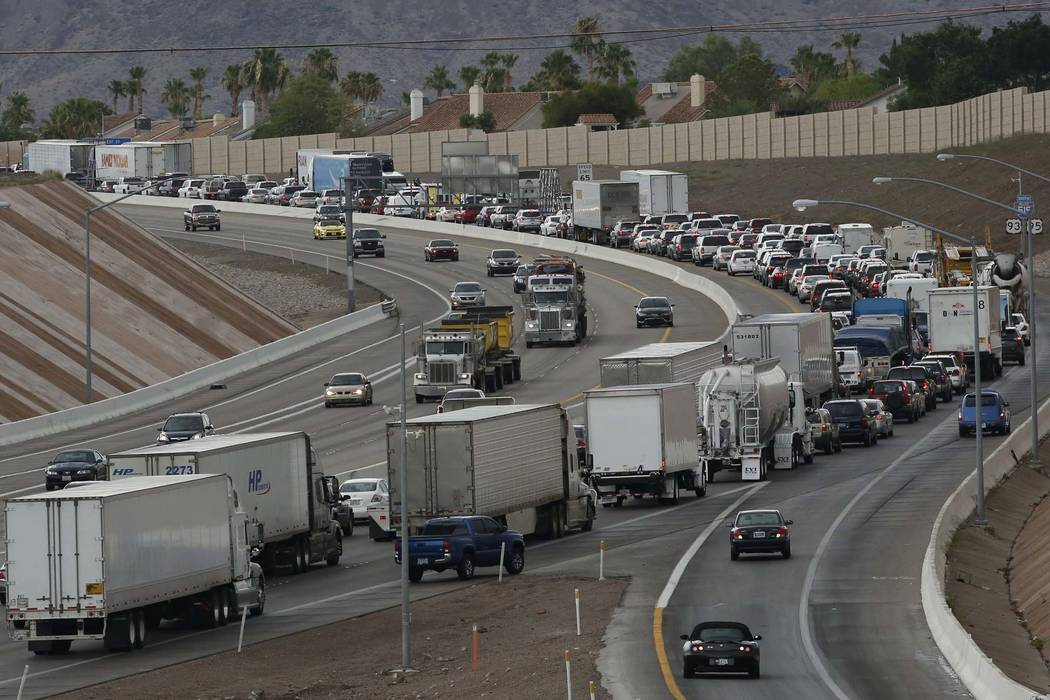 Flooding on U.S. Highway 95 has closed the freeway near College Drive in Henderson, affecting southbound traffic, Thursday, July 12, 2018. (Bizuayehu Tesfaye/Las Vegas Review-Journal) @bizutesfaye